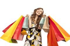 Mulher nova que admira sua compra Imagem de Stock
