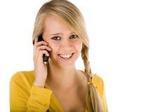 mulher nova que chama pelo telefone fotografia de stock
