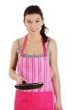 Mulher nova que cozinha o alimento saudável Fotografia de Stock Royalty Free