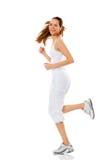 Mulher nova que faz a ginástica no branco imagem de stock royalty free