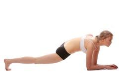 Mulher nova que faz o exercício da ioga fotografia de stock royalty free