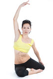 Mulher nova que faz o exercício da ioga Imagem de Stock Royalty Free