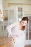 Mulher nova que faz o housework Foto de Stock Royalty Free