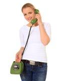 Mulher nova que faz um atendimento de telefone Fotografia de Stock Royalty Free