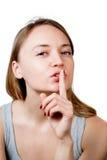 Mulher nova que gesticula para quieto ou que Shushing Imagens de Stock