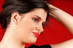 Mulher nova que joga com cabelo Imagem de Stock Royalty Free