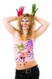 Mulher nova que joga com tinta Fotografia de Stock