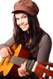 Mulher nova que joga a guitarra Imagens de Stock Royalty Free
