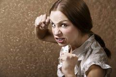 Mulher nova que joga um perfurador Fotografia de Stock