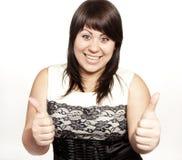 Mulher nova que mostra a mão o sinal aprovado Fotografia de Stock