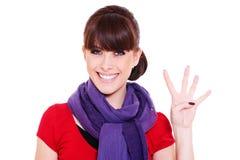Mulher nova que mostra o número quatro Imagem de Stock Royalty Free