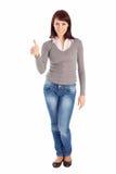 Mulher nova que mostra o sinal APROVADO foto de stock royalty free