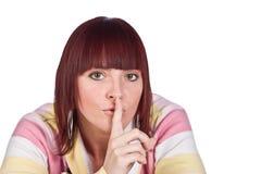Mulher nova que mostra quiet com o dedo, isolado Imagem de Stock Royalty Free
