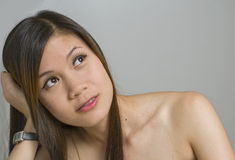 Mulher nova que olha acima Imagem de Stock