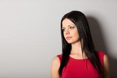 Mulher nova que olha afastado Fotografia de Stock