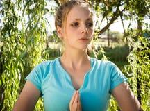 Mulher nova que praying Imagem de Stock Royalty Free