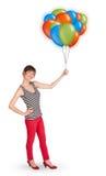 Mulher nova que prende balões coloridos Imagem de Stock Royalty Free