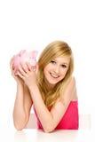 Mulher nova que prende o banco Piggy Imagens de Stock