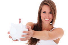 Mulher nova que prende o banco piggy Imagem de Stock