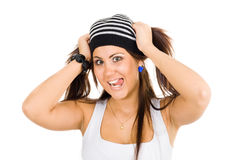 Mulher nova que prende seus ponytails Foto de Stock
