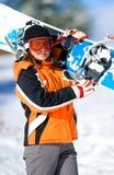 mulher nova que prende um snowboard Imagem de Stock Royalty Free