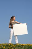 Mulher nova que prende uma bandeira Imagens de Stock Royalty Free