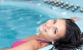 Mulher nova que relaxa Imagem de Stock Royalty Free