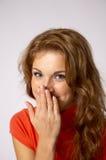 Mulher nova que sorri tìmida Fotografia de Stock Royalty Free