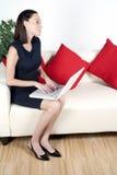 Mulher nova que trabalha da HOME Foto de Stock Royalty Free