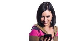 Mulher nova que usa o telefone móvel Fotos de Stock