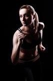 Mulher nova Running Foto de Stock Royalty Free