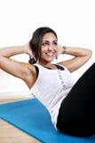 A mulher nova senta-se acima Imagens de Stock
