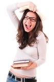 Mulher nova Shouting com livros Fotografia de Stock
