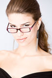 Mulher nova Smirking Foto de Stock Royalty Free