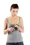 A mulher nova triste tem que destruir seu cartão de crédito Fotos de Stock Royalty Free