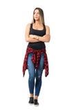 Mulher ocasional nova séria com os braços cruzados que olham acima foto de stock royalty free
