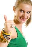 Mulher ocasional que sorri com seus polegares acima Fotografia de Stock