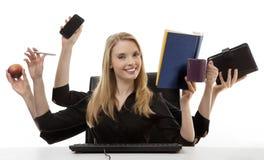 Mulher ocupada em sua mesa imagens de stock royalty free
