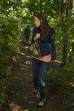 Mulher paranoide na floresta Imagens de Stock Royalty Free