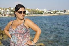 Mulher pelo mar Imagem de Stock Royalty Free
