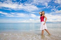 Mulher pelo mar Imagens de Stock Royalty Free