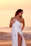 Mulher pelo oceano Imagens de Stock
