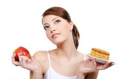 Mulher pensativa bonita com alimento Foto de Stock Royalty Free