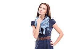 Mulher pensativa bonita que olha acima Imagens de Stock Royalty Free