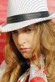 Mulher pensativa com chapéu Imagens de Stock