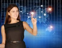 A mulher pressiona o dedo indicador no mundo de incandescência do ponto Imagens de Stock