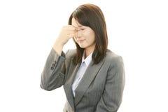 Mulher que é cansado Foto de Stock Royalty Free