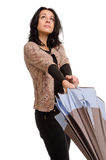 Mulher que abre um guarda-chuva Fotografia de Stock Royalty Free