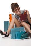 Mulher que admira sua compra Imagens de Stock Royalty Free