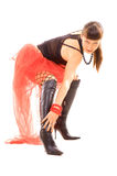Mulher que afaga seus pés longos Fotos de Stock